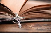 Christian Cross Necklace On A Holy Bible, Christianity And Religion Concept. poster
