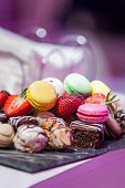 Gourmet Desserts. A Plate Full Of Christmas Desserts. Close Up Of Macaroons On A Table. poster