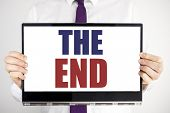 Word, Writing The End. Business Concept For End Finish Close Written On Tablet Laptop Holding By Man poster