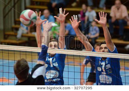 KAPOSVAR, HUNGARY - APRIL 21: Andras Geiger (R) in action at a Hungarian National Championship volleyball game Kaposvar (blue) vs. Kecskemet (black), April 21, 2012 in Kaposvar, Hungary.