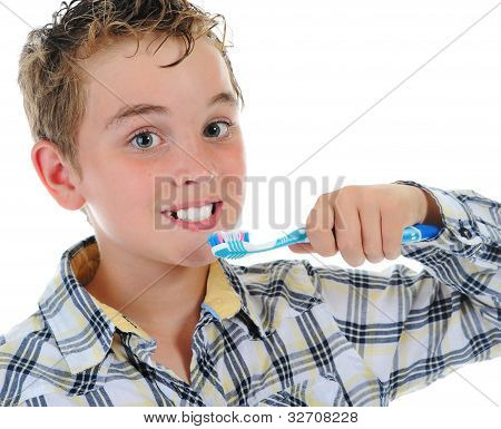 beautiful little boy cleans your teeth