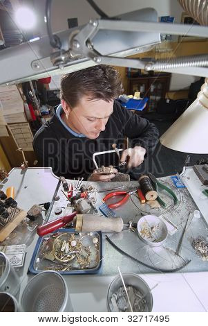 Goldsmith In His Laboratory
