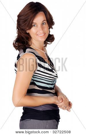 beautiful brunette business woman in her 30s wearing a top with stripes and pearls looking over her shoulder on the white background.