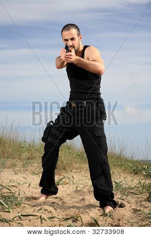 Male Bodyguard With A Gun