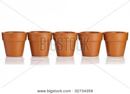 Row of Clay Empty Flower Pot  isolated on white