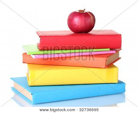 Composition of schoolbooks and an apple isolated on white
