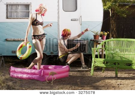 Women Outside A Trailer