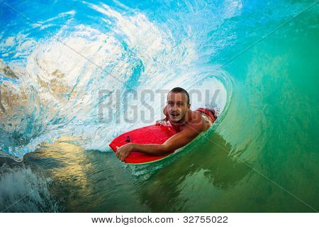 Body Boarder on Large Wave Surfing in the Tube Getting Barreled