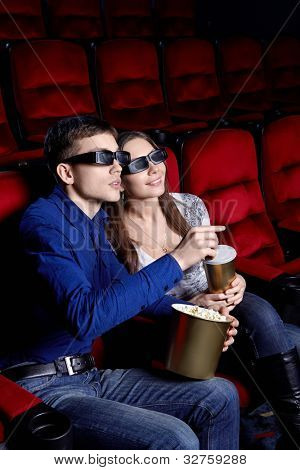 A couple in a movie theater
