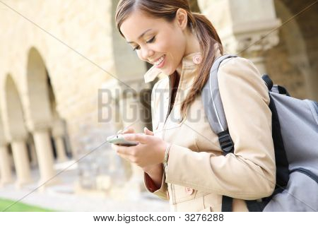 Pretty Girl On Cell Phone At School