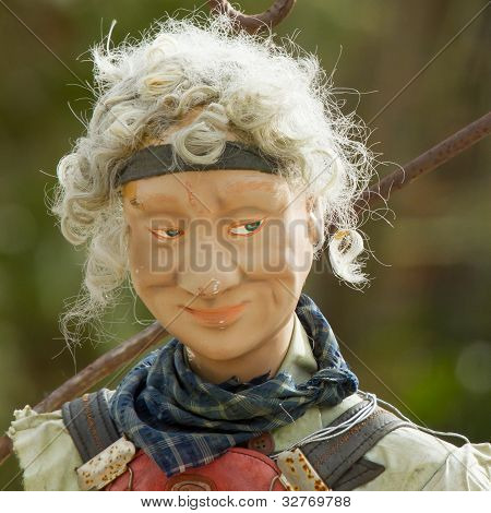 An Old Plastic Statue Of A Man