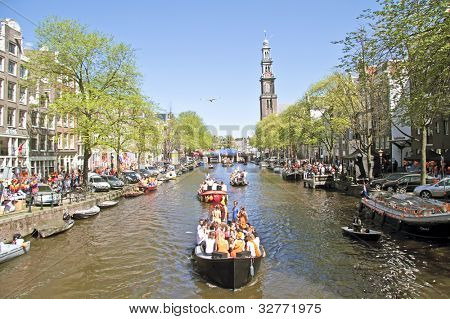 AMSTERDAM,NETHERLANDS, APRIL 30: On the canals people are celebrating queens day on April 30, 2012  in Amsterdam,Netherlands.