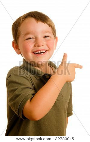 Portrait of young boy child pointing a direction isolated on white