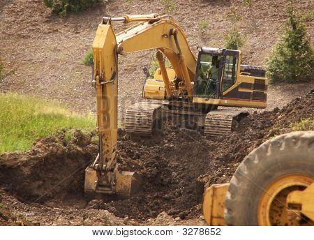 Excavator Digs Dirt