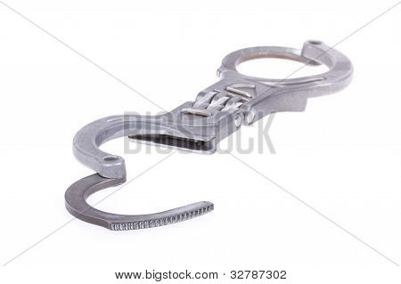 A Close-up Of Metal Handcuffs