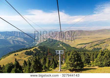 poster of Summer Mountain Landscape High In The Mountains. Tall Trees Of Christmas Trees, Ski Lift At The Ski