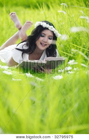 Asian Woman Reading Outdoor