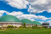 Anaerobic digesters or Biogas plant producing biogas from agricultural waste in rural Germany. Moder poster