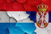 Flags Of Luxembourg And Serbia Painted On Cracked Wall poster
