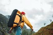 Brave Tourist Wearing Yellow Jacket With Travel Backpack Hiking In Mountains Outdoor Journey. Active poster