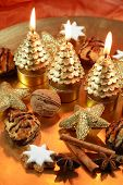 stock photo of christmas bells  - Christmas still life with beautiful candles on golden tone - JPG