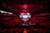 Blurred Background Of An Esports Event - Main Stage Venue, Big Screen And Lights Before The Start Of poster