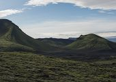 Volcanic Landscape With Blue Container, Tindfjallajokull Glacier, Green Hills And Lava Gravel Ground poster