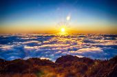 Nature Background With Sunrise Over Clouds. It Is On The Top Of Pico Do Arieiro Mountain, Madeira Is poster
