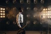 Black jazz musician with saxophone on the stage poster