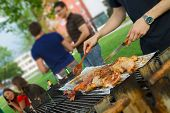 stock photo of tilt  - Chicken quarters and sausages on the grill - JPG