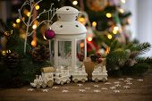 Christmas Decoration With White Lantern,pine And Cones, Gift Box,and Bauble White Train On Wood Tabl poster