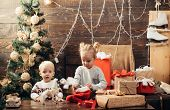 Winter Kids. Christmas Card. Cute Little Kids Celebrating Christmas. Joyful Baby Looking At Camera I poster