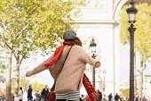 Beautiful Woman With Hands Outstretched In Paris. Vacations Lifestyle. Woman Expressing Happiness .v poster