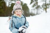 Adorable Young Girl Having Fun In Beautiful Winter Park. Cute Child Playing In A Snow. Winter Activi poster