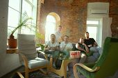 Group Of Excited Friends Playing Video Games At Home. Caucasian Male Gamers Or Fans Spending Time An poster