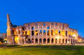 The Colosseum In Rome, Italy At Sunset Twilight. Blue Hour Photo In The Evening. The World Famous Co poster