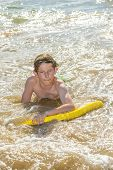 stock photo of papagayo  - boy has fun surfing in the waves - JPG