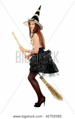 Playful Young Woman With A Besom