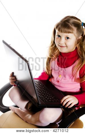Girl With Laptop In Chair