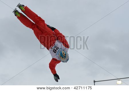 BUKOVEL, UKRAINE - FEBRUARY 23: Andreas Isoz, Switzerland performs aerial skiing during Freestyle Ski World Cup in Bukovel, Ukraine on February 23, 2013.