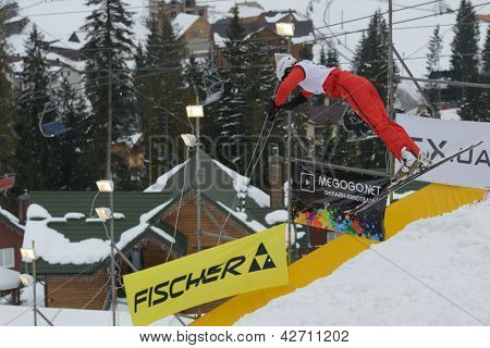 BUKOVEL, UKRAINE - FEBRUARY 23: Tanja Schaerer, Switzerland performs aerial skiing during Freestyle Ski World Cup in Bukovel, Ukraine on February 23, 2013.