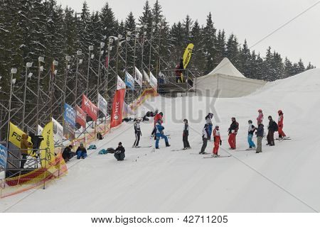 BUKOVEL, UKRAINE - FEBRUARY 23: Female competitors at the start of aerial skiing during Freestyle Ski World Cup in Bukovel, Ukraine on February 23, 2013.