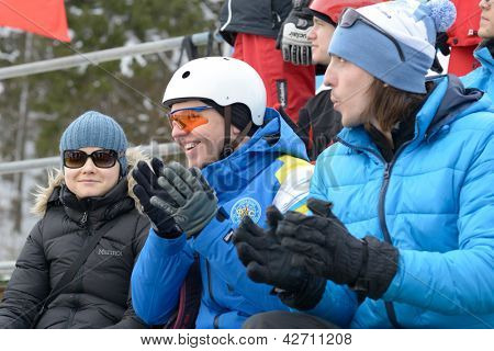 BUKOVEL, UKRAINE - FEBRUARY 23: Spectators and member of teams watch the competitions in aerial skiing during Freestyle Ski World Cup in Bukovel, Ukraine on February 23, 2013
