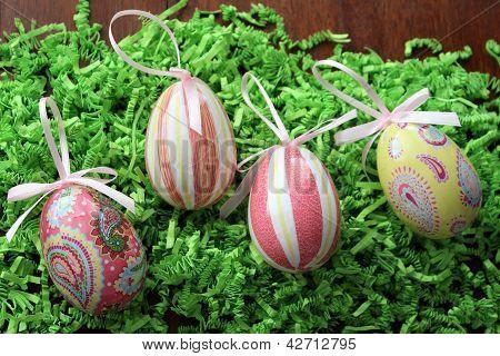 Pretty decorative eggs on shredded grass