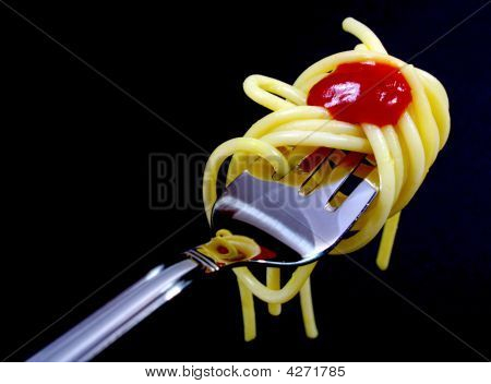 Pasta On Fork On Black Background