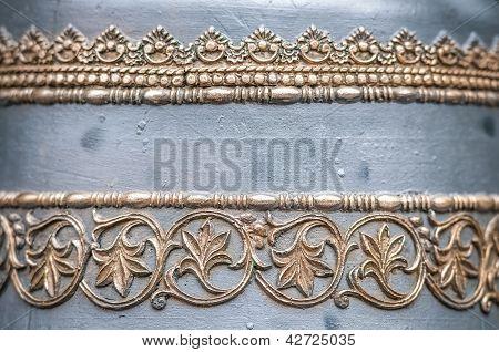 Bell in details: metal golden ornament.