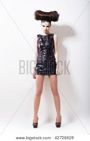 Emo. Haute Couture. Impressive Whistical Woman In Black Leather Dress On Podium