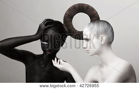 Ying & Yang Symbol. East Culture. Women Painted Body In Black & White