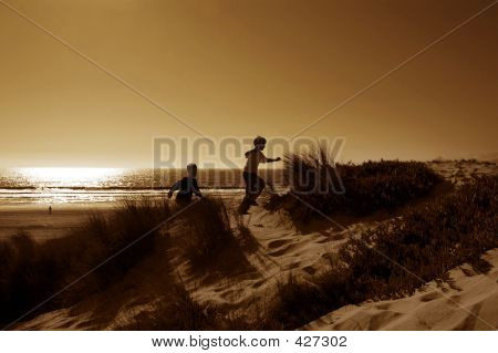 Boys Running In Dunes
