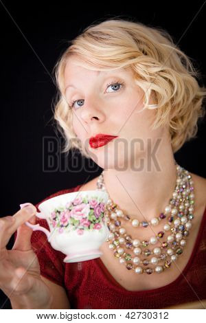 Beautiful Snobbish lady holding a cup of tea